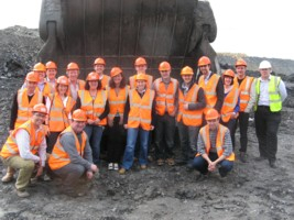 Banks Group members posing in front of a dumper truck, May 2010